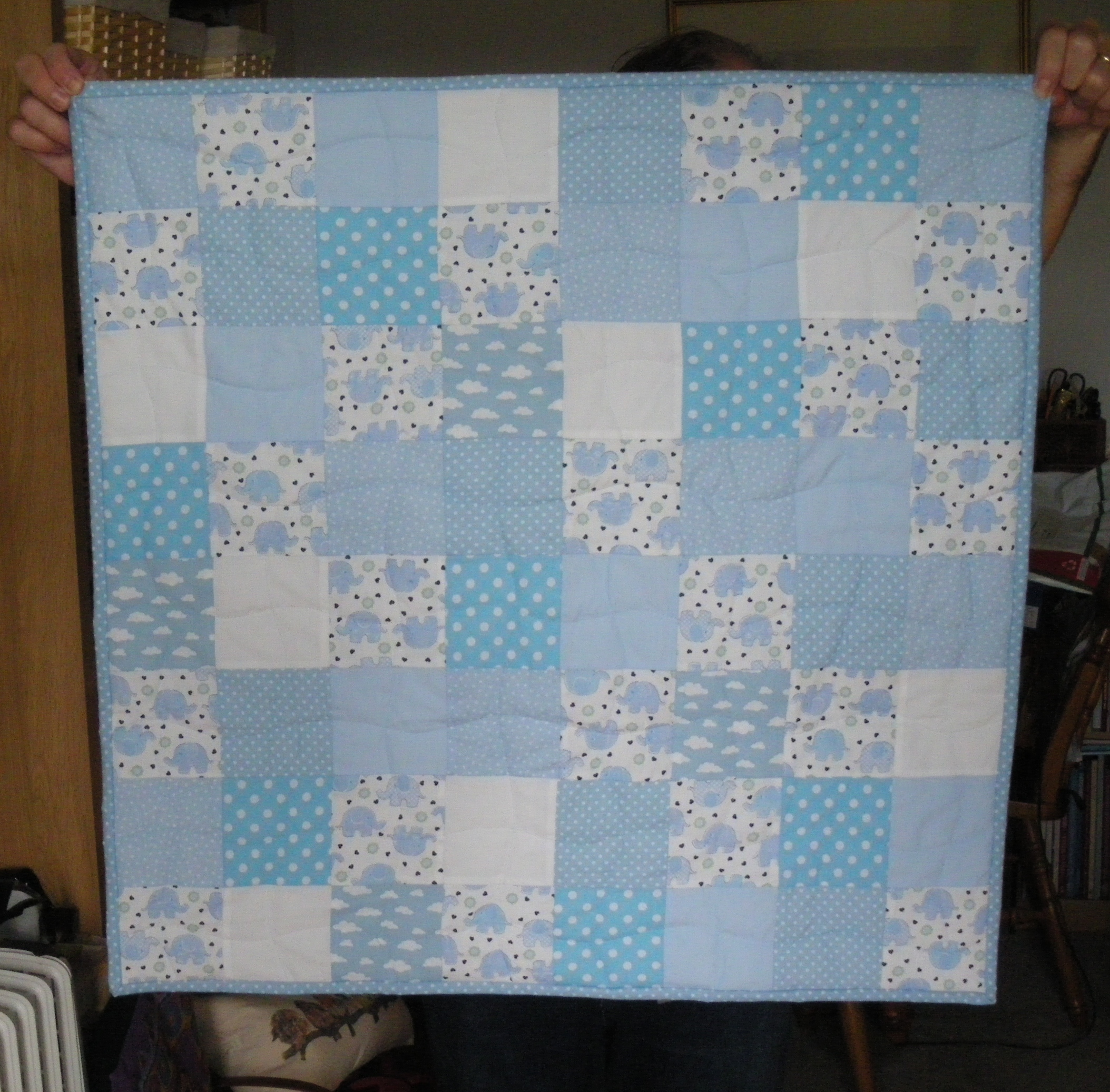 Baby quilt hanging